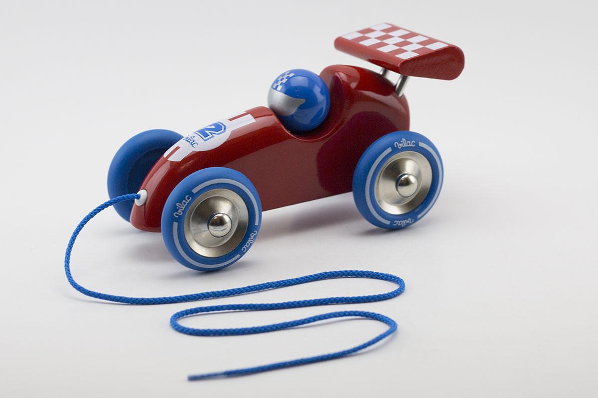 Voiture de course à traîner pour les petits pilotes en herbe.